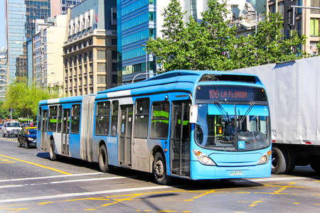SANTIAGO, CHILE - NOVEMBER 13, 2015: Blue articulated city bus Marcopolo Gran Viale in the city street. Editorial