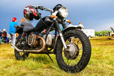 undefined: NOVYY URENGOY, RUSSIA - JUNE 25, 2016: Undefined retro motorcycle at the countryside.
