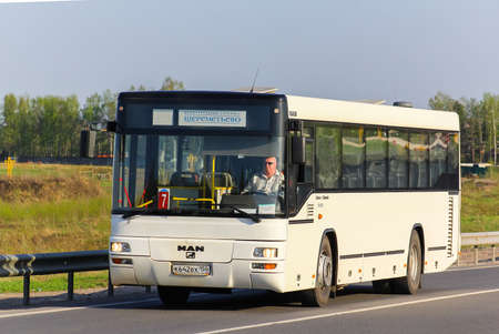intercity: MOSCOW, RUSSIA - MAY 9, 2013: White suburban bus MAN A74 Lions Classic at the intercity road.