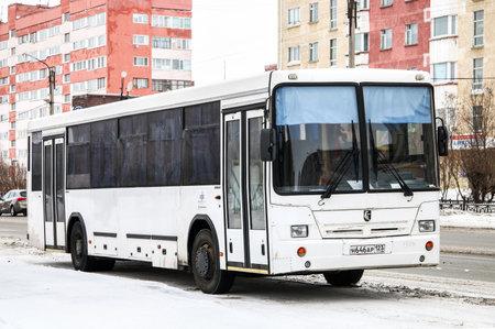 convey: NOVYY URENGOY, RUSSIA - FEBRUARY 27, 2016: White suburban bus Nefaz 5299 in the city street.
