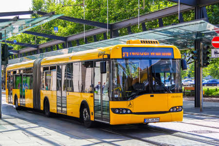 18 20: DRESDEN, GERMANY - JULY 20, 2014: Articulated city bus Solaris Urbino 18 in the city street.