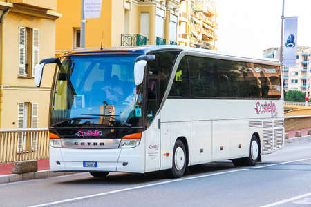 outside machines: MONTE CARLO, MONACO - AUGUST 2, 2014: White coach bus Setra S415HD in the city street.