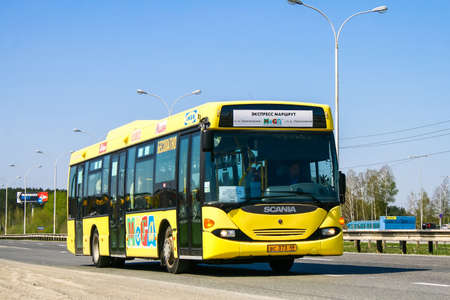 YEKATERINBURG, RUSSIA - MAY 9, 2010: Yellow city bus Scania OmniLink at the suburban road.
