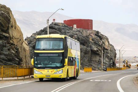 intercity: CHANARAL, CHILE - NOVEMBER 18, 2015: Yellow intercity coach Modasa Zeus at the interurban freeway.