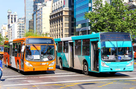 megapolis: SANTIAGO, CHILE - NOVEMBER 13, 2015: City buses Marcopolo Gran Viale and Caio in the city street.
