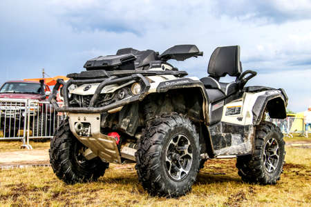 outlander: NOVYY URENGOY, RUSSIA - JUNE 25, 2016: Quad bike Can-Am BRP Outlander at the countryside. Editorial