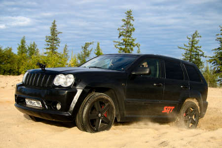cherokee: NOVYY URENGOY, RUSSIA - AUGUST 6, 2016: Off-road car Jeep Grand Cherokee SRT-8 at the countryside. Editorial