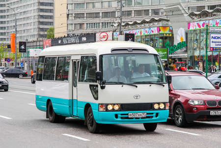 toyota: MOSCOW, RUSSIA - MAY 6, 2013: Interurban bus Toyota Coaster in the city street.