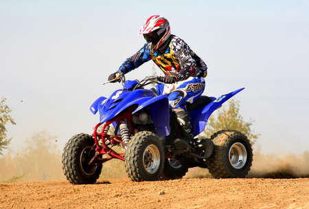 NOVYY URENGOY, RUSSIA - AUGUST 30: Undefined competitors quad bike Yamaha No. 3 competes at the annual Russian Motocross Championship on August 30, 2012 in Novyy Urengoy, Russia.