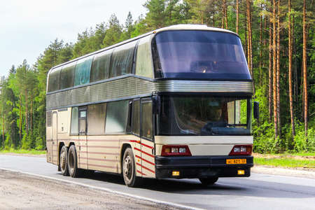 intercity: NIZHNY NOVGOROD REGION, RUSSIA - MAY 21, 2013: Intercity coach bus Neoplan N1223 Skyliner at the interurban freeway.