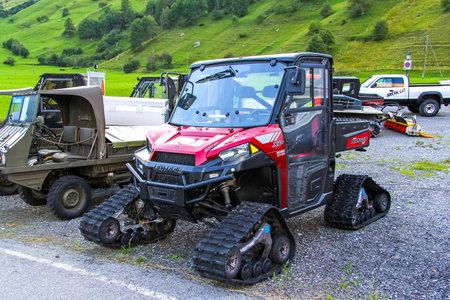 VALAIS, SWITZERLAND - AUGUST 5, 2014: Off-road vehicle Polaris Ranger XP in the Alpine village.