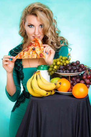 vices: Eating young woman. Gluttony (Gula) is one of Seven Deadly Sins. Stock Photo
