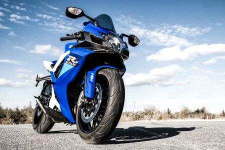 NOVYY URENGOY, RUSSIA - AUGUST 21, 2016: Blue bike Suzuki GSX-R750 parked at the countryside.
