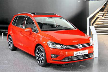 WOLFSBURG, GERMANY - AUGUST 14, 2014: Modern car Volkswagen Golf Sportsvan in the trade center of the Volkswagen Autostadt.