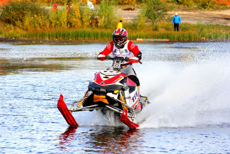 undefined: NOVYY URENGOY, RUSSIA - SEPTEMBER 2: Undefined competitors BRP Ski-Doo Snowmobile No. 111 competes at the annual Yamal Watercross Championship on September 2, 2012 in Novyy Urengoy, Russia. Editorial