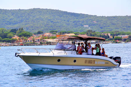 SAINT-TROPEZ, FRANCE - AUGUST 3, 2014: Small pleasure boat at the city bay.