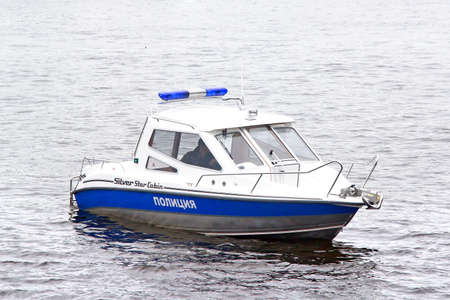 SAINT PETERSBURG, RUSSIA - MAY 26, 2013: Small police boat at the Neva river. Editorial