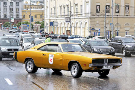 museum rally: MOSCOW, RUSSIA - JUNE 3, 2012: American muscle car Dodge Charger competes at the annual L.U.C. Chopard Classic Weekend Rally.