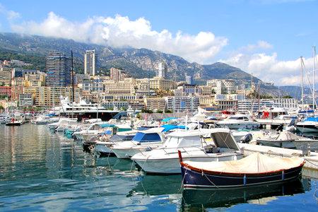 super yacht: MONTE CARLO, MONACO - AUGUST 2, 2014: View of the Monaco bay and Monte Carlo architecture. Editorial