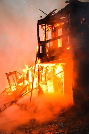 ablaze: Fire in an old wooden house Stock Photo