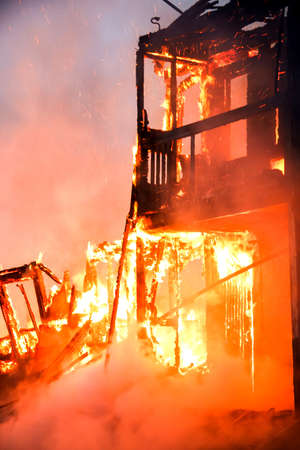 Fire in an old wooden house Stock Photo
