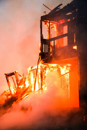 caving: Fire in an old wooden house Stock Photo