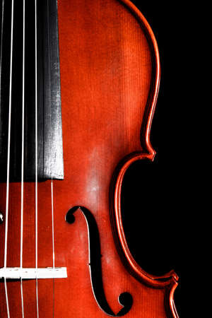Violin isolated over black background