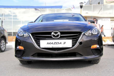 mazda: NOVYY URENGOY, RUSSIA - JUNE 1, 2014: Black Mazda 3 motor car presented at the annual Autosalon Motor show.