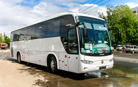 outside machines: UFA, RUSSIA - MAY 15, 2008: Brand new coach bus Marcopolo Andare 1000 in the city street.