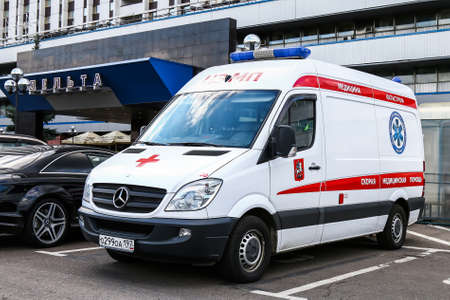 cross street with care: MOSCOW, RUSSIA - SEPTEMBER 2, 2016: Ambulance car Mercedes-Benz Sprinter in the city street.