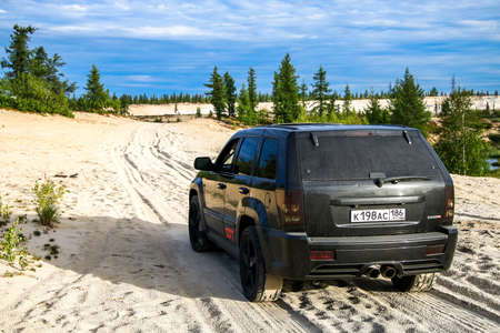 cherokee: NOVYY URENGOY, RUSSIA - AUGUST 6, 2016: Off-road car Jeep Cherokee SRT-8 at the countryside. Editorial