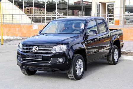 NOVYY URENGOY, RUSSIA - JUNE 1, 2014: Pickup truck Volkswagen Amarok in the city street.