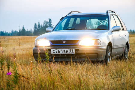 utilitarian: NOVYY URENGOY, RUSSIA - AUGUST 11, 2016: Motor car Nissan Wingroad at the countryside.