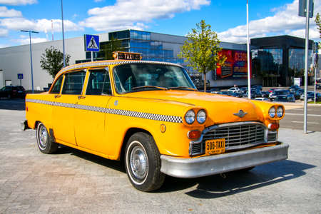 checker: MOSCOW, RUSSIA - SEPTEMBER 1, 2016: Yellow Checker taxi of New York in the city street.