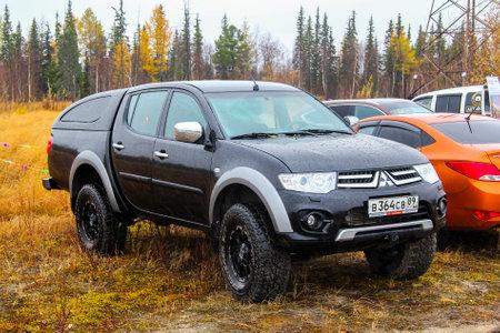 mmc: NOVYY URENGOY, RUSSIA - SEPTEMBER 19, 2015: Pickup truck Mitsubishi L200 at the countryside.