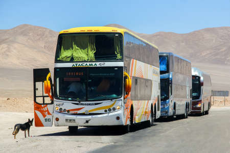 ATACAMA, CHILE - NOVEMBER 18, 2015: Intercity coach Busscar Panoramico DD at the roadside in the Atacama desert.