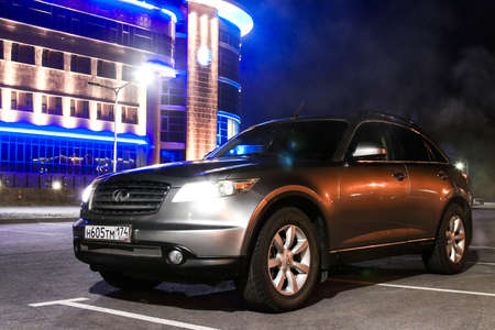 NOVYY URENGOY, RUSSIA - OCTOBER 15, 2016: Grey motor car Infiniti FX35 in the city street.
