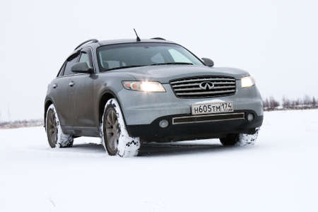 NOVYY URENGOY, RUSSIA - OCTOBER 20, 2016: Grey motor car Infiniti FX35 in the snow covered tundra. Editorial