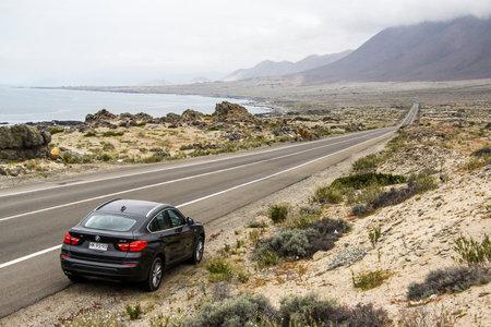 double cross: ATACAMA, CHILE - NOVEMBER 14, 2015: Black motor car BMW F26 X4 at the roadside.