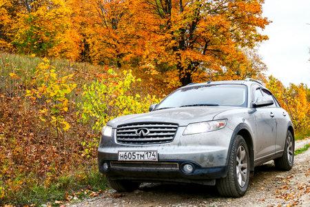 ASHA, RUSSIA - SEPTEMBER 28, 2016: Grey motor car Infiniti FX35 in autumn forest.