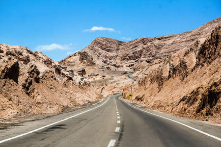 Road through the Atacama desert in Chile Stock Photo