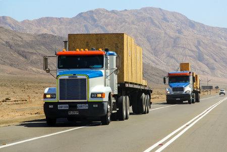 freightliner: ATACAMA, CHILE - NOVEMBER 18, 2015: Semi-trailer truck Freightliner FLD at the interurban road.
