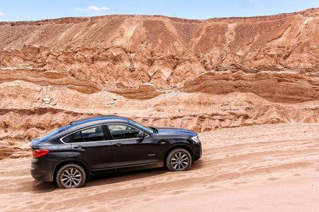 crossover: ANTOFAGASTA, CHILE - NOVEMBER 15, 2015: Modern black crossover BMW X4 xDrive 2.8i (F26) in the Valle de la Muerte (Mars Valley) in the Atacama Desert.