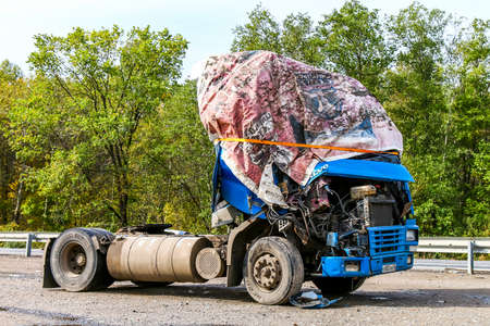 contorted: CHELYABINSK REGION, RUSSIA - SEPTEMBER 22, 2016: Crashed semi-trailer truck Volvo FH12 at the interurban road. Editorial