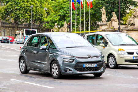 PARIS, FRANCE - AUGUST 8, 2014: Motor car Citroen C4 Picasso in the city street. Editorial