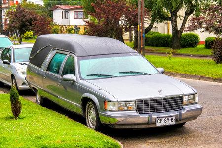 hearse: VALDIVIA, CHILE - NOVEMBER 20, 2015: Hearse car Cadillac Fleetwood in the town street.