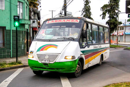 chilean: TOCONAO, CHILE - NOVEMBER 22, 2015: Small city bus Metalpar in the town street.