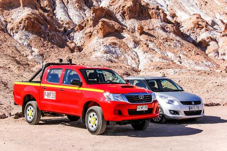 ANTOFAGASTA, CHILE - NOVEMBER 17, 2015: Red pickup truck Toyota Hilux in the Moon Valley (Valle de la Luna) in the Atacama desert.