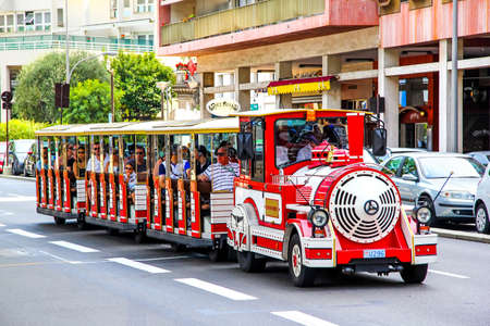 trackless: LA CONDAMINE, MONACO - AUGUST 2, 2014: Touristic sightseeing trackless train in the city street.