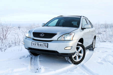 lexus auto: NOVYY URENGOY, RUSSIA - NOVEMBER 5, 2016: Silver motor car Lexus RX330 in the snow covered tundra. Editorial
